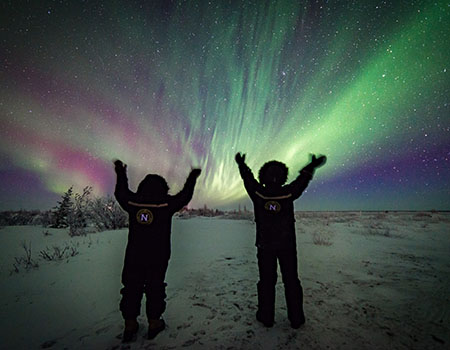 Tourists view the northern lights