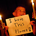 Boy holding Earth Hour sign