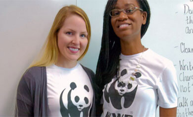 Two Panda Ambassadors posing in WWF t-shirts